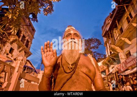 Sadhu, Indian holy man in Abhaya Mudra gesture - Stock Photo