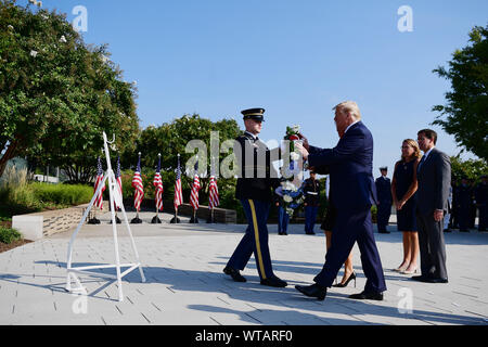 Arlington, Virginia, USA. 11th Sep, 2019. United States President Donald J. Trump lays a wreath at the Pentagon during the 18th anniversary commemoration of the September 11 terrorist attacks, in Arlington, Virginia on Wednesday, September 11, 2019. Credit: Kevin Dietsch/Pool via CNP Credit: Kevin Dietsch/CNP/ZUMA Wire/Alamy Live News - Stock Photo