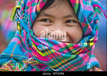 Native Hmong young girl wearing colorful clothes