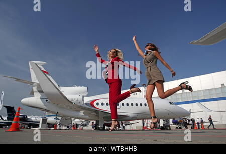 Moscow, Russia. 11th Sep, 2019. MOSCOW, RUSSIA - SEPTEMBER 11, 2019: Women at RUBAE 2019, Russian Business Aviation Exhibition, at the Vnukovo-3 business aviation centre. Marina Lystseva/TASS Credit: ITAR-TASS News Agency/Alamy Live News - Stock Photo