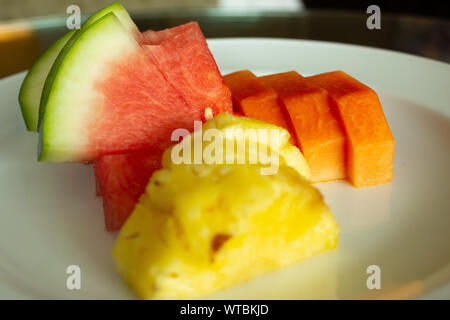 Cut fruits arranged in a plate - Stock Photo
