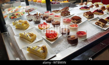 Buffet many cake, sweet on the food line, Different dessert cakes for sale at the shop. - Stock Photo