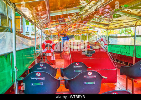 BANGKOK, THAILAND - APRIL 24, 2019: The empty ferry tourist boat standing at the ferry pier on Saensaeb canal, on April 24 in Bangkok - Stock Photo