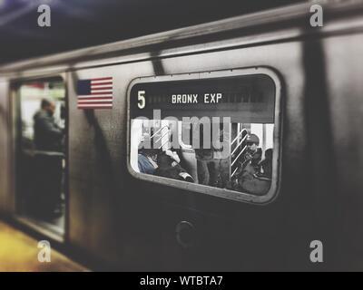 View Of Passengers In Subway Train - Stock Photo