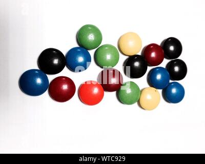 Multi Colored Candies Against White Background - Stock Photo
