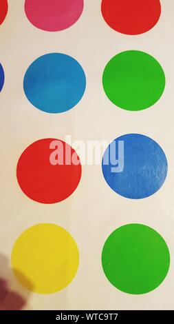 Full Frame Shot Of Colorful Circles On White Wall - Stock Photo