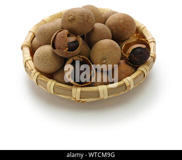 dried longan fruits isolated on white background - Stock Photo