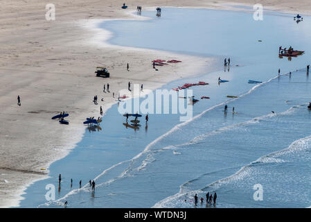 Surfers take to the surf at Saunton Sands, near Croyde, North Devon, England UK - Stock Photo