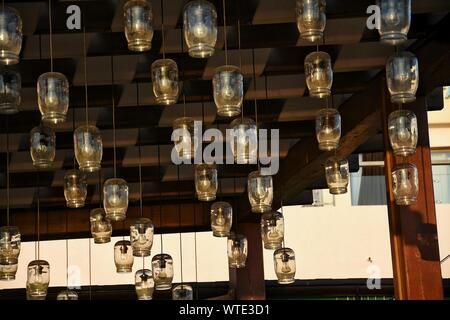 Low Angle View Of Pendant Lights Hanging From Ceiling - Stock Photo
