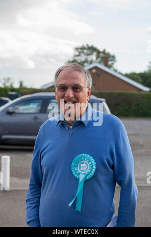 Sedgefield, Stockton on Tees, UK. 11th September 2019. The Brexit Party were holding a conference at Sedgefield Racecourse where Nigel Farage was the main speaker. A Brexit Party supporter outside the venue with his rosette. David Dixon / Alamy - Stock Photo