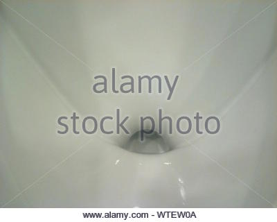Full Frame Shot Of Urinal In Bathroom - Stock Photo