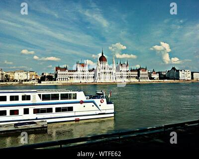 Ship Moving On Danube River In Front Of Hungarian Parliament Building - Stock Photo