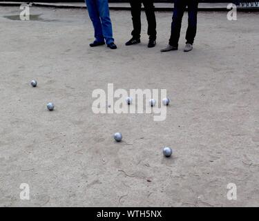 Low Section Of People Playing Petanque - Stock Photo