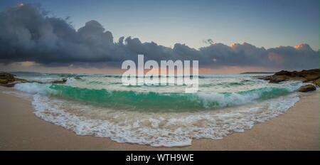 Sea Waves Rushing Towards Sand At Beach - Stock Photo