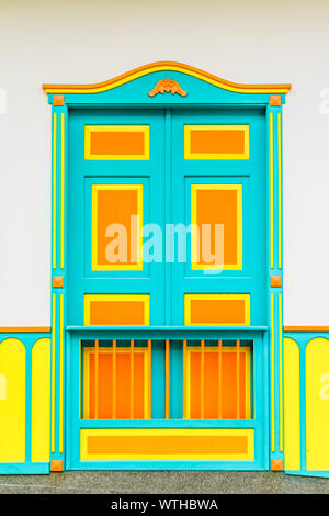 View on colorful door of colonial building in the city of Filandia, Colombia - Stock Photo