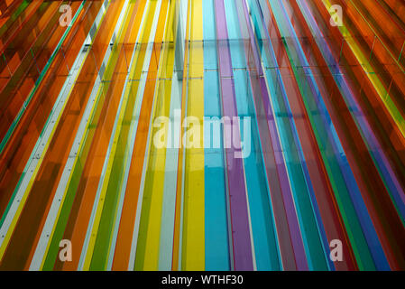 Vertical colourful stripes inside building. Converging lines decoration. Art installation in University Museum Contemporary Art, Mexico City, Mexico - Stock Photo