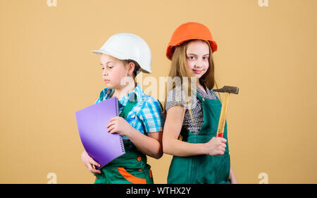 Home improvement activity. Kids girls with tools planning renovation. Family remodeling house. Children sisters renovation their room. Control renovation process. Kids happy renovating home. - Stock Photo