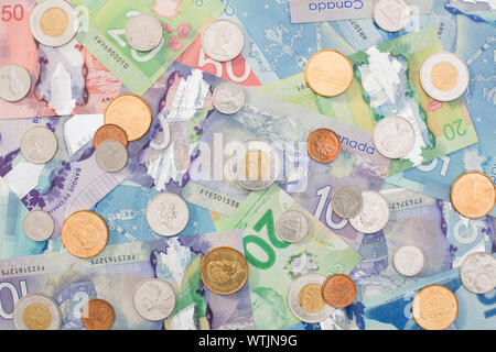 Canadian paper currency and coins - Stock Photo