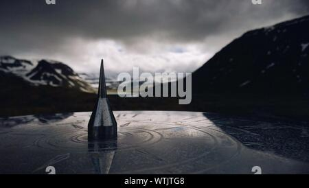 Close-up Of Sundial With Mountains On Background - Stock Photo
