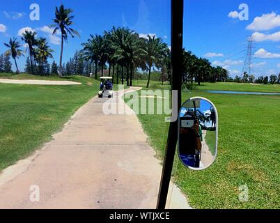 Golf Carts On Footpath Against Sky - Stock Photo