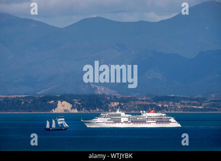 Picture by Tim Cuff - 16 February 2019 - Cruise ship approaching Port Nelson with the sailing ship Spiriti of New Zealand sailing out, Nelson, New Zea - Stock Photo