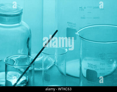 Close-up Of Measuring Beakers With Stirrer In Laboratory - Stock Photo