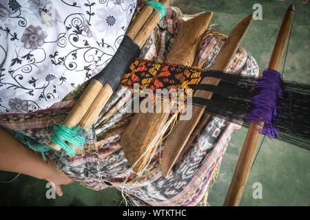 Woman Weaving Belt on Traditional Belt Loom in San Pedro la Laguna, Guatemala - Stock Photo