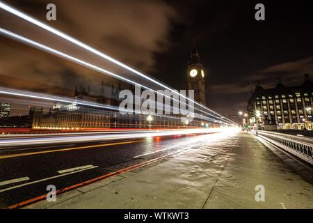 Light Trails On Westminster Bridge By Big Ben At Night - Stock Photo