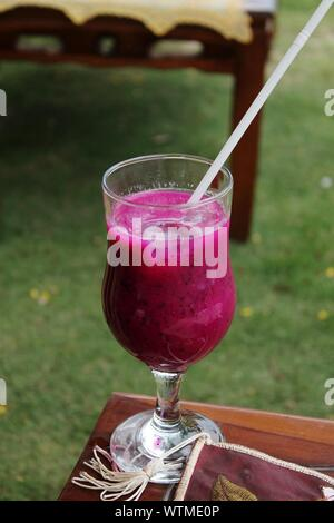 Close-up Of Dragon Fruit Smoothie On Table - Stock Photo