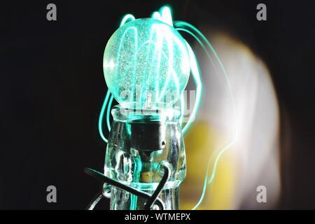 Digital Composite Image Of Illuminated Light Bulb - Stock Photo