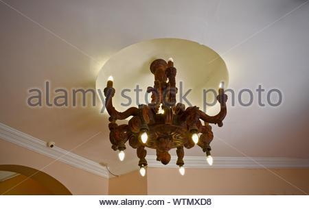 Antique lamp in mahogany wood. - Stock Photo