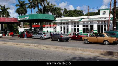 People wait to fill their cars with fuel at a gas station in Havana, Cuba, 11 September 2019. The arrival of fuel to Cuba was interrupted on Tuesday and will not resume until next day 14, the country's president, Miguel Díaz-Canel, said. Among the measures to deal with the crisis is 'lower activity levels a little to ensure that the fuel can endure until the end of the month' said Economy Minister Alejandro Gil, in addition to shifting some industrial activities so that they do not develop in 'rush hours' of energy consumption. EFE/ Ernesto Mastrascusa - Stock Photo