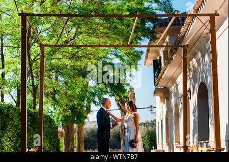 Just married couple looking at each other after wedding ceremony - Stock Photo