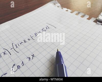 Close-up Of Mathematical Equation On Paper - Stock Photo