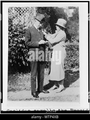 Mrs. Calvin Coolidge enrolls the President in the American Red Cross - Stock Photo