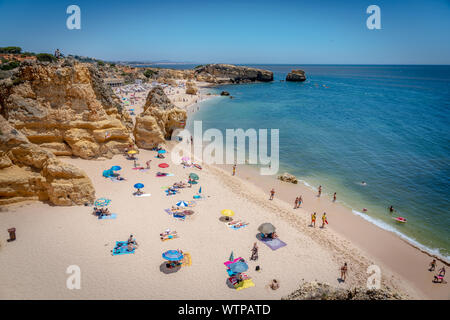 June 28th 2019 - Algarve, Portugal - Tourists and locals enjoying the amazing beach of Sao Rafael in a blue sky day in southern Portugal, Algarve - Stock Photo