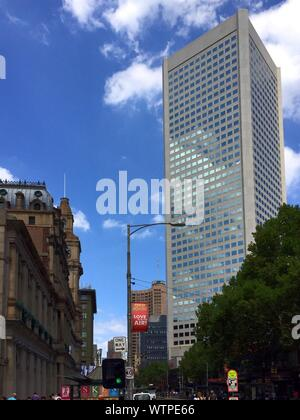 Low Angle View Tall Office Building Against Sky At Elizabeth Street - Stock Photo