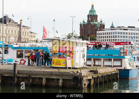 Ticket Kiosk selling Sightseeing Fares at Market Square in Helsinki Finland - Stock Photo