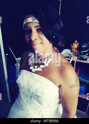 Portrait Of Smiling Bride In Wedding Dress - Stock Photo