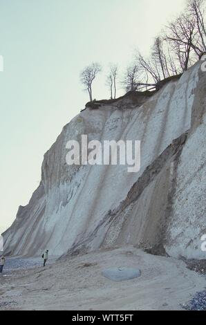 People Standing By Chalk Cliff At Jasmund National Park - Stock Photo