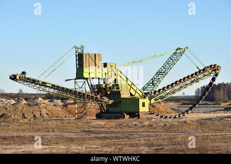 Stone crusher in the quarry. Working mining machine - stone crusher. Quarrying of stones for construction works. Mining industry - Stock Photo