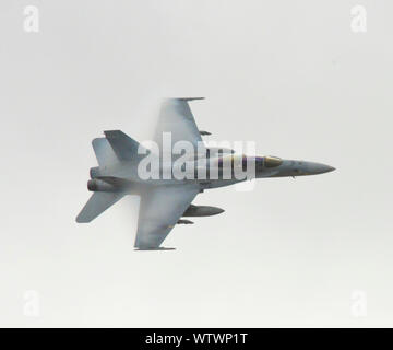 Low Angle View Of Fighter Plane In Sky - Stock Photo