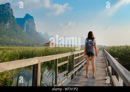 Young woman relaxing in park. Sam Roi Yod National Park, Thailand