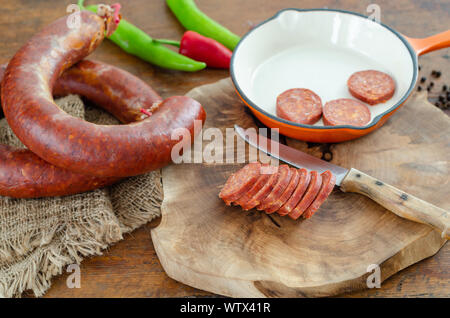 Turkish sausage sucuk on a cutting board - Stock Photo