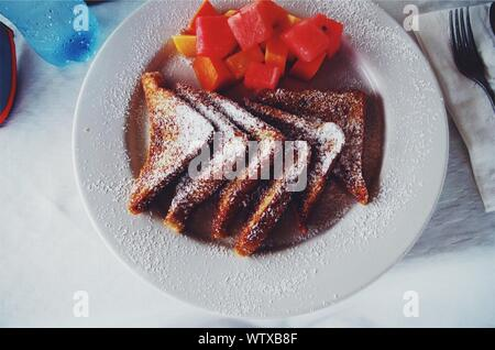 High Angle View Of French Toast And Fruits In Plate - Stock Photo