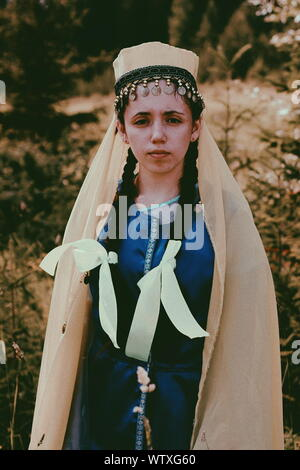 Portrait Of Young Woman Wearing Headdress While Standing Outdoors - Stock Photo