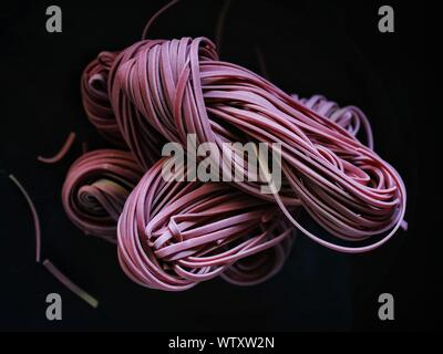 Close-up Of Rubber Bands Over Black Background - Stock Photo