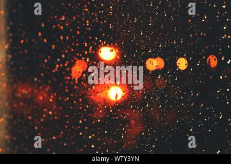 Rain Drops On Windshield And Out Of Focus City Lights - Stock Photo