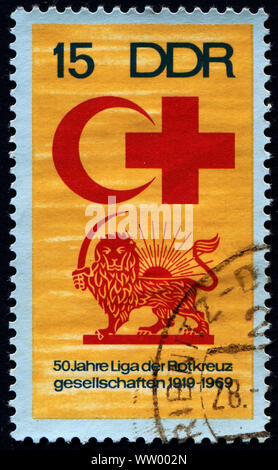 GERMANY,  CIRCA 1969: Postage stamp printed in GERMANY (DDR), dedicated to the International Red Cross and crescent,  circa 1969 - Stock Photo