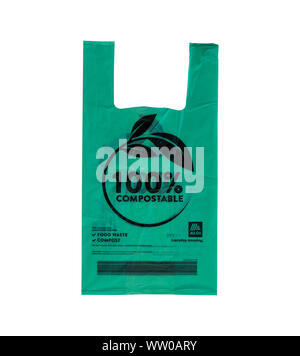 Aldi Supermarket new green compostable carrier bag isolated on a white background - Stock Photo